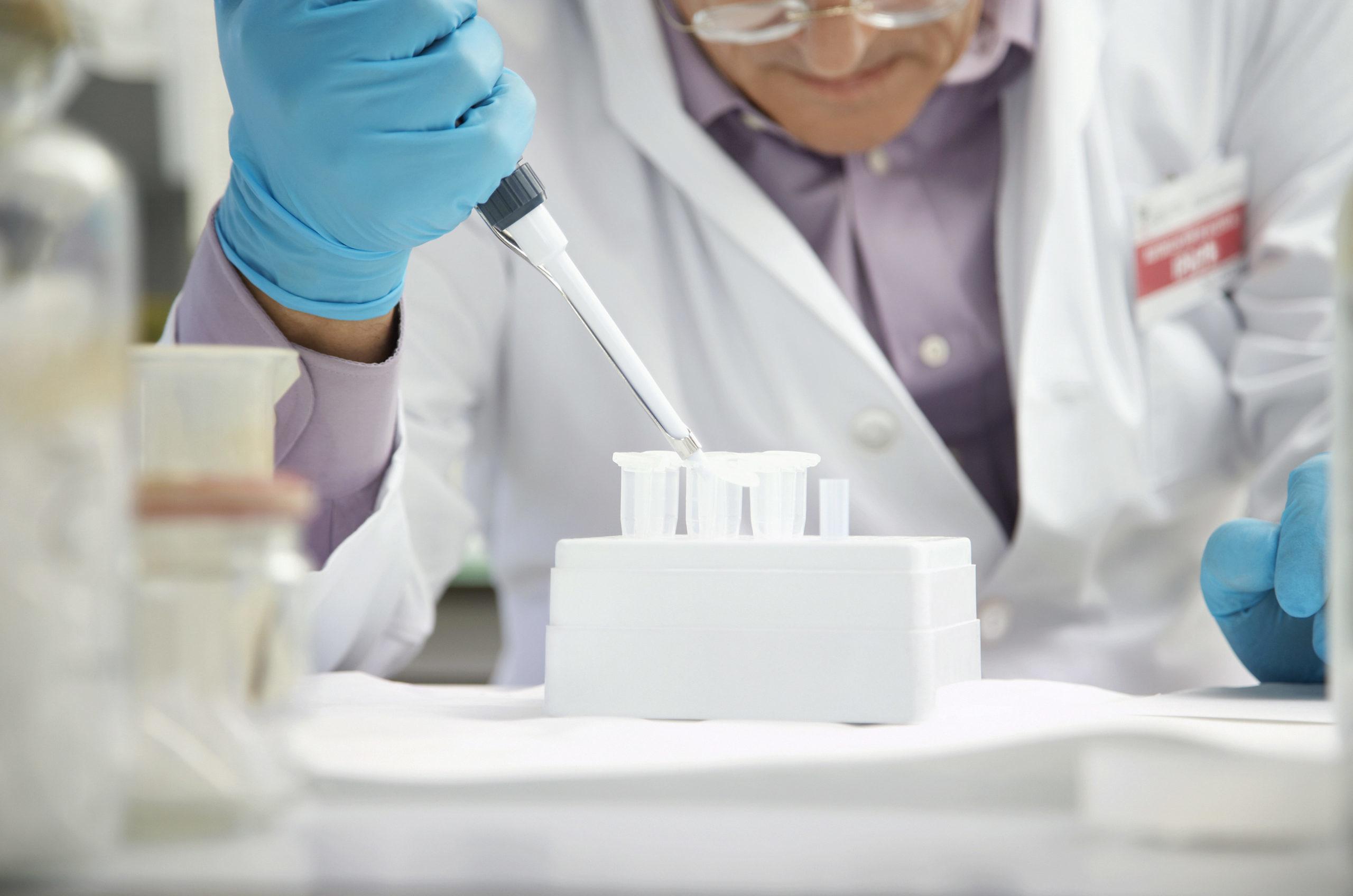 Lab Technician Using Pipette